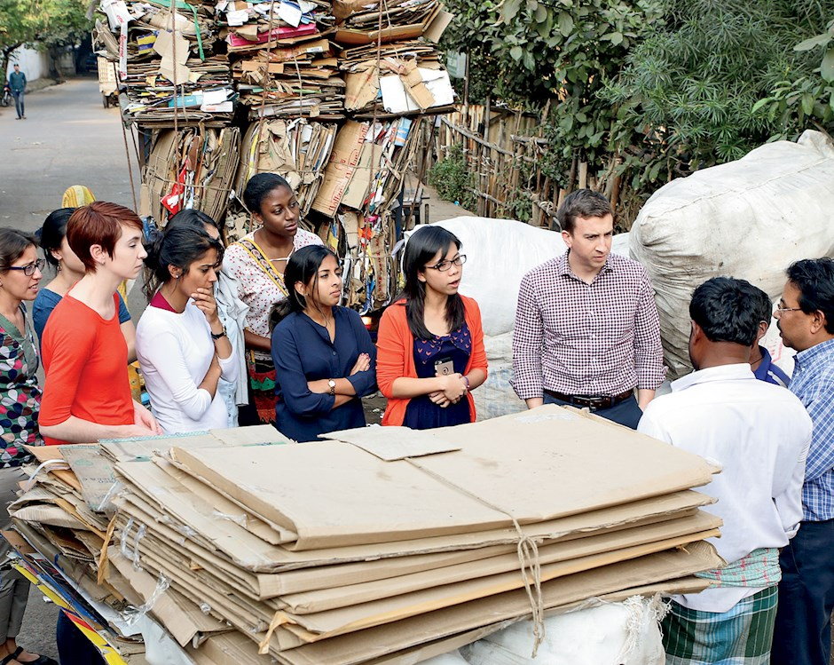 Booth students in India speaking to village stakeholders