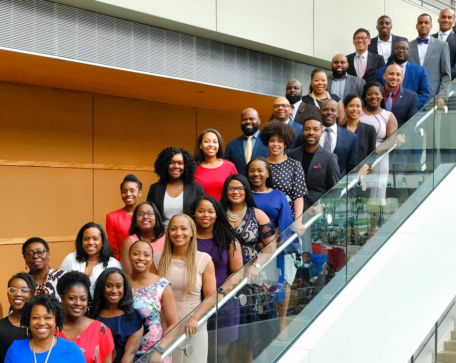 2019 IMPACT Fellows posing on stairs at Harper Center